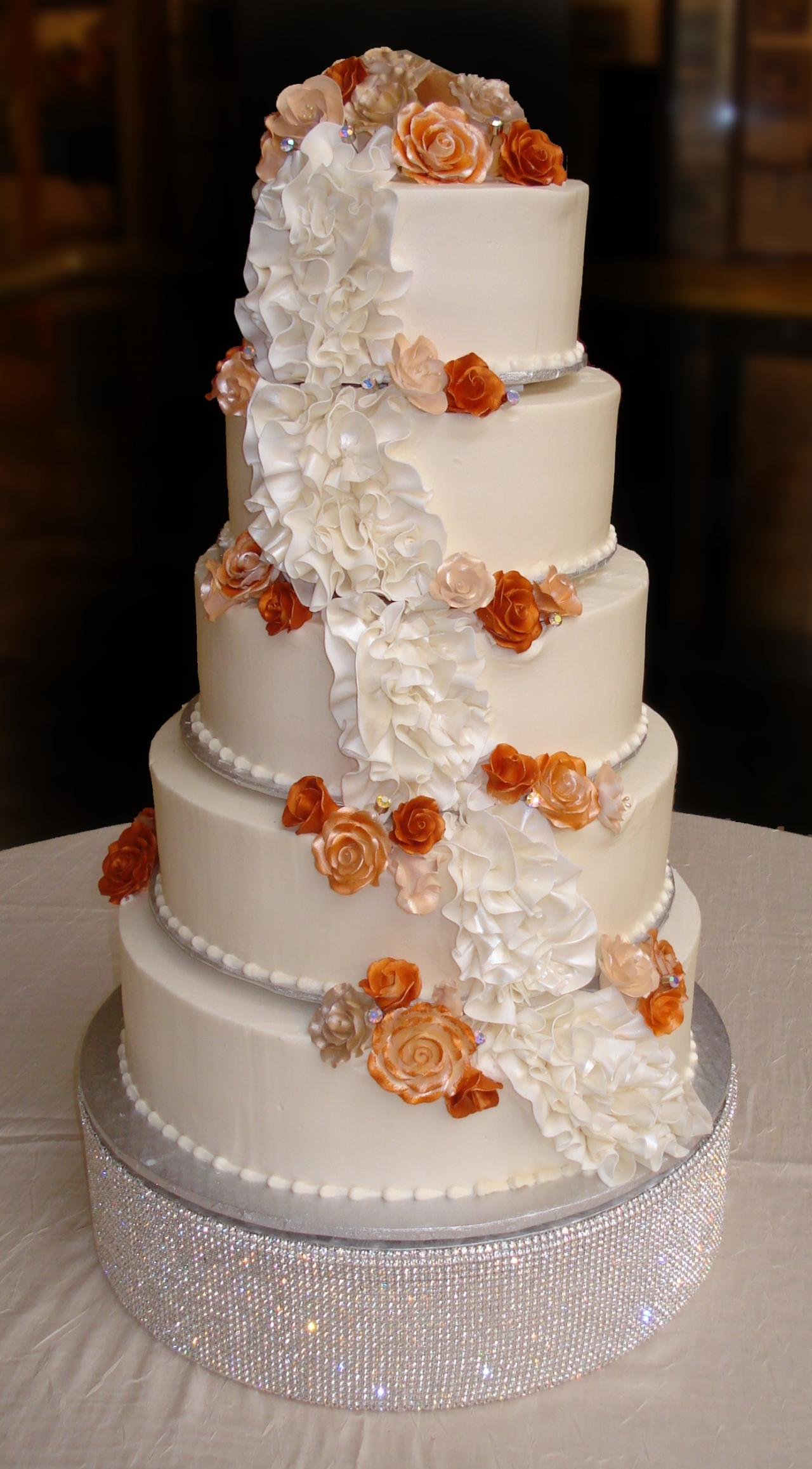 Candlelight Buttercream Iced 5 Tier Round Wedding Cake Decorated With Fondant Ruffles Matte And