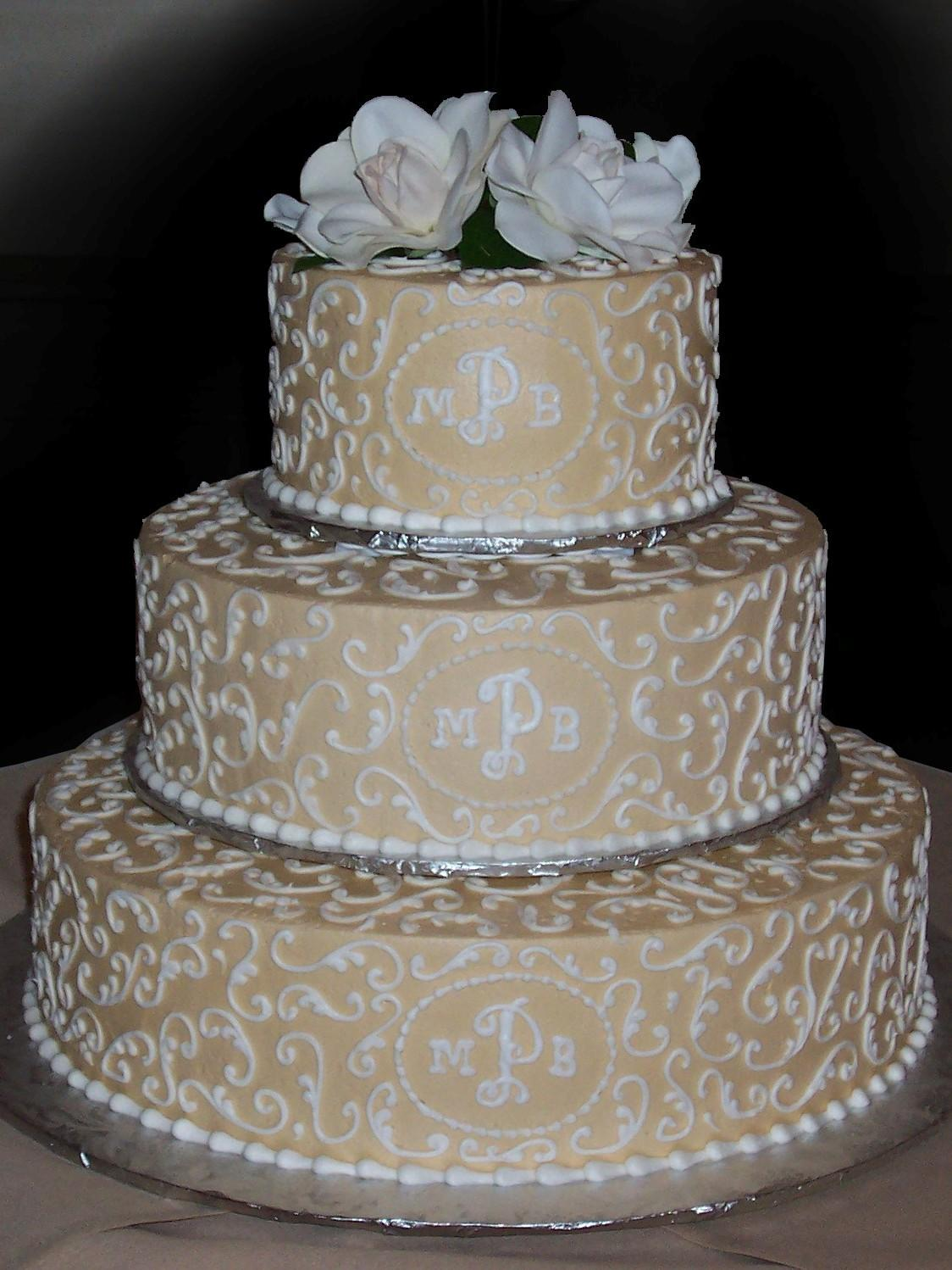 Champagne Gold Buttercream Iced 3 Tiered Wedding Cake Contrasting White Scroll Work On All