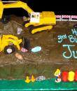 Construction 3rd Birthday Cake,  Chocolate buttercream iced,  sheet cake decorated with everything your 3 year old needs to run his own construction site. Bulldozer, backhoe, cones, jelly bean rocks, and workers.  Everything on this cake is EDIBLE.  (Plastic character figurine was provided by client). (Serves 24-98 party slices)