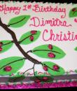 Ladybugs on Leaves 1st Birthday Cake. White buttercream iced, sheet decorated with ladybugs resting on the leaves. Everything on this cake is edible. )Serves 24-98 party slices.)