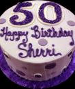Purple Polka Dot 50th Birthday Cake,  Purple buttercream iced,   round decorated with purple polka dots.  Everything on this cake is EDIBLE.  (Serves 8-80 party slices)